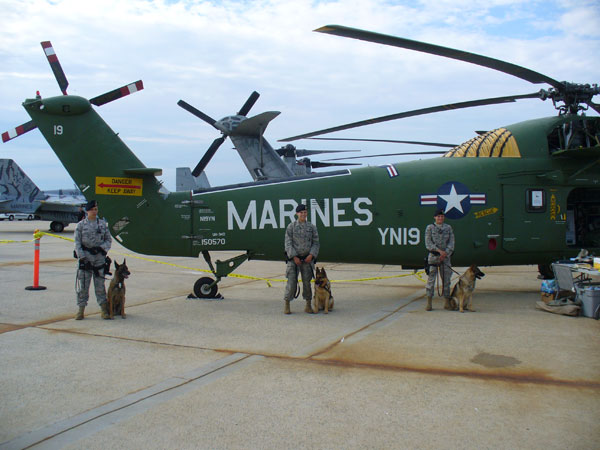USAF K-9s and handlers next to our helicopter.